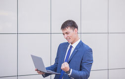 Young business man think look up hold tablet pc Stock Photo