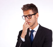 Young business man thinking Royalty Free Stock Photos