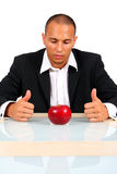 Young Business Man Thinking With Apple Royalty Free Stock Photography
