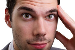 Young business man thinking hard, worried Royalty Free Stock Photo