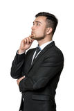 Young business  man, thinking about something, isolated on a white background Royalty Free Stock Photography