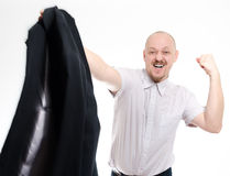 Mad business man punching. Young business man throwing suit Royalty Free Stock Photography
