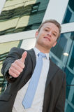 Young business man with thumb up Stock Photos