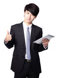 Young business man thumb up with touch pad Stock Images