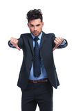 Young business man with thumbs down hand gesture. On white background royalty free stock photography