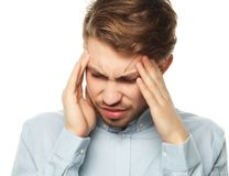 Young business man touching his head and keeping eyes closed. Terrible headache. Young business man touching his head and keeping eyes closed while standing stock photography