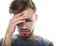 Young business man touching his head and keeping eyes closed royalty free stock images