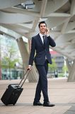 Young business man traveling with bag Stock Photography