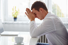 Young business man under stress. With headache Stock Image