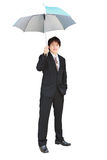 Young business man under an umbrella Royalty Free Stock Image