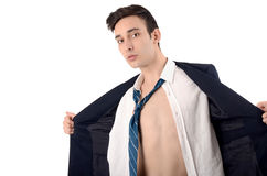 Young business man undressing his suit. Royalty Free Stock Photos