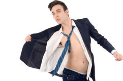 Young business man undressing his suit. Royalty Free Stock Image