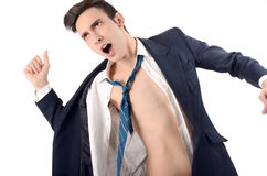 Young business man undressing his suit. Stock Photo