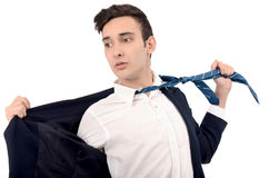 Young business man undressing his suit, pulling his tie. Stock Image