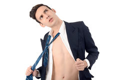 Young business man undressing his suit, pulling his tie. Royalty Free Stock Photo