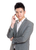 Young business man using cell phone Royalty Free Stock Images