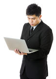 Young business man using laptop computer Stock Photos