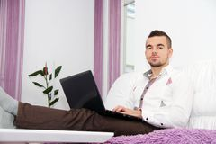 Young Business man Using Laptop At Home Royalty Free Stock Photo