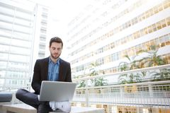 Young business man using laptop Royalty Free Stock Photography
