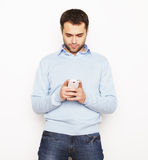 Young business man using mobile phone. Life style, business  and people concept: Young business man using mobile phone.Over white background Royalty Free Stock Image