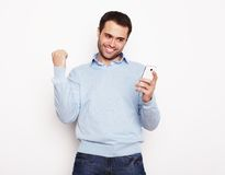 Young business man using mobile phone. Life style, business  and people concept: Young business man using mobile phone.Over white background Stock Photography