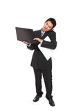 Young business man using notebook isolated Royalty Free Stock Photography