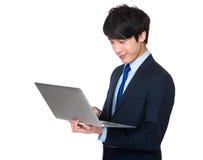 Young business man using notebook Stock Photos