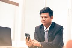 Young business man using smart phone. Business concept Royalty Free Stock Images