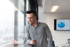 Young business man using smart phone at office Royalty Free Stock Images