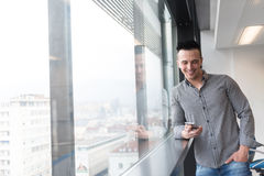 Young business man using smart phone at office Stock Images