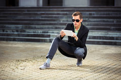 Young business man using a tablet computer outdoor Stock Photography