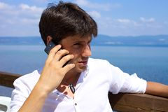 Young business man in vacation on the phone Royalty Free Stock Photo