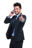 Young business man with very good news on the phone Royalty Free Stock Photos