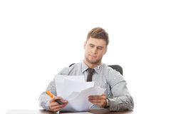 Young business man viewing documents. Stock Photos