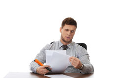 Young business man viewing documents. Stock Photography