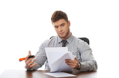 Young business man viewing documents. Royalty Free Stock Image