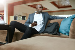 Young business man waiting in hotel lobby Stock Photography