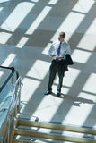 Young Business Man Waiting in Lobby Royalty Free Stock Photos
