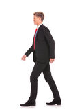 Young business man walking forward Stock Photos