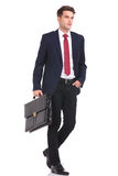 Young business man walking with his hand in pocket Stock Photography
