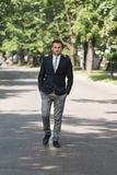 Young Business Man Walking Outdoors In Park Royalty Free Stock Image