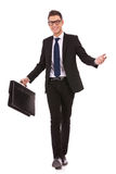 Young business man walking and welcoming Royalty Free Stock Photos