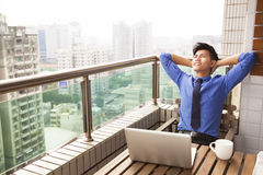 Young business man watching the city view Stock Photo