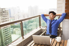 Young business man watching the city view Stock Images