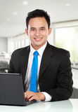 Young Business Man With A Laptop Stock Photography