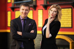 Young business man and woman against office buildi Royalty Free Stock Photo