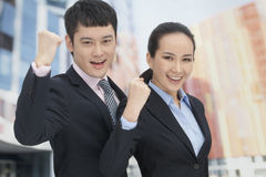 Young business man and woman cheering Royalty Free Stock Photos