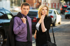 Young business man and woman on the city street Stock Photos