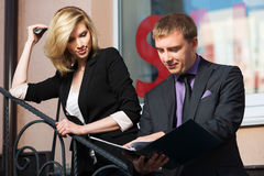 Young business man and woman with a folder  Royalty Free Stock Image