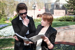 Young business man and woman. Young business men and women discussing Royalty Free Stock Images